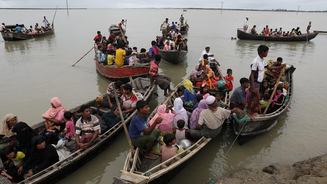 Rohingya refugees who arrived from Myanmar last night by boat, get into other boats to go to the main land, in Teknaf, Bangladesh, October 7, 2017. REUTERS/Mohammad Ponir Hossain