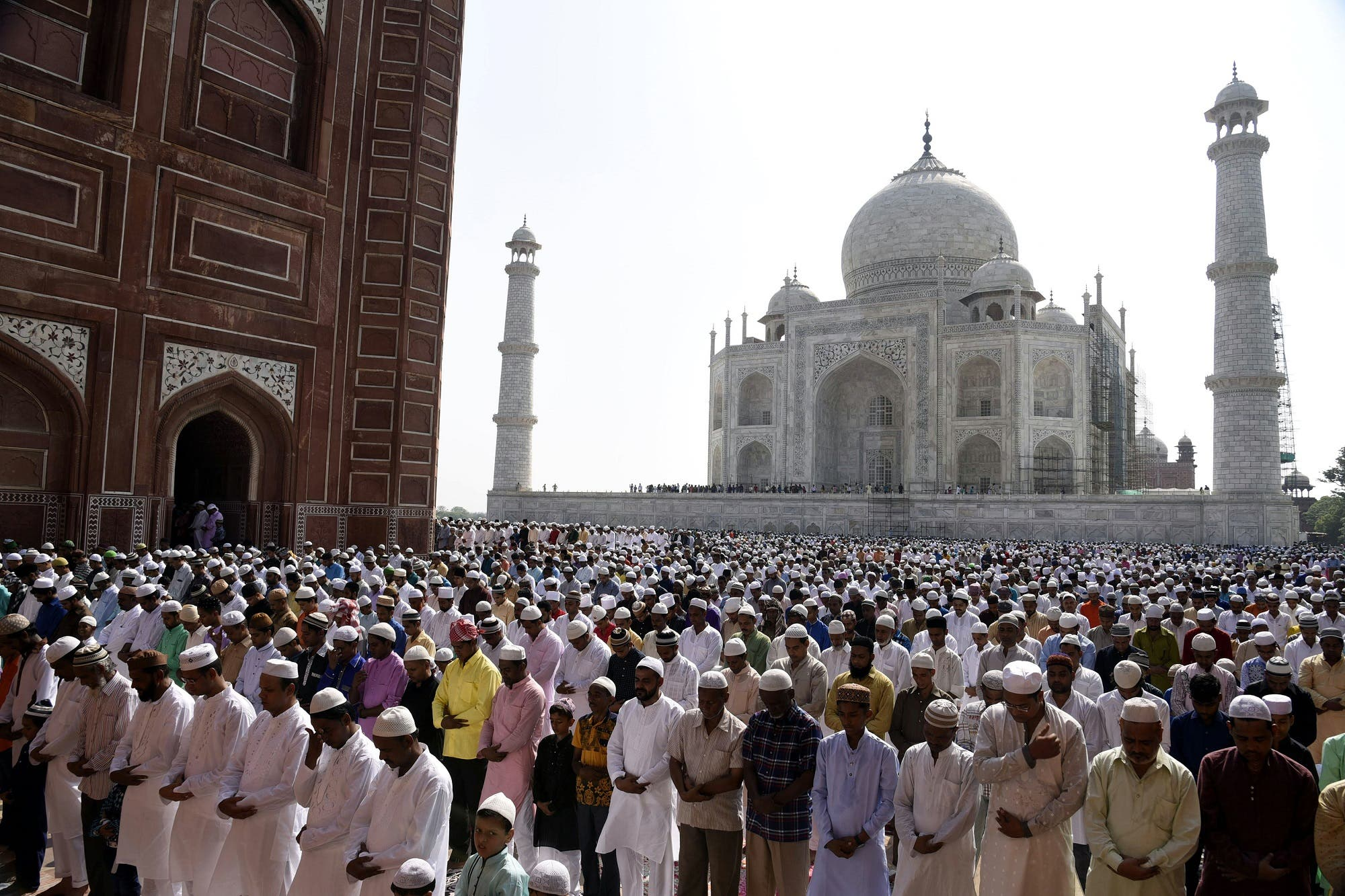 Indian Muslims offer Eid al-Fitr prayers by the Taj Mahal in Agra on June 26, 2017. (AFP)