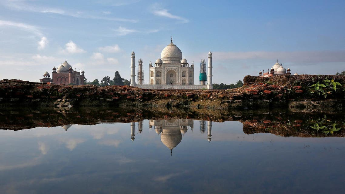 The Taj Mahal is reflected in a puddle in Agra on August 9, 2016. (Reuters)
