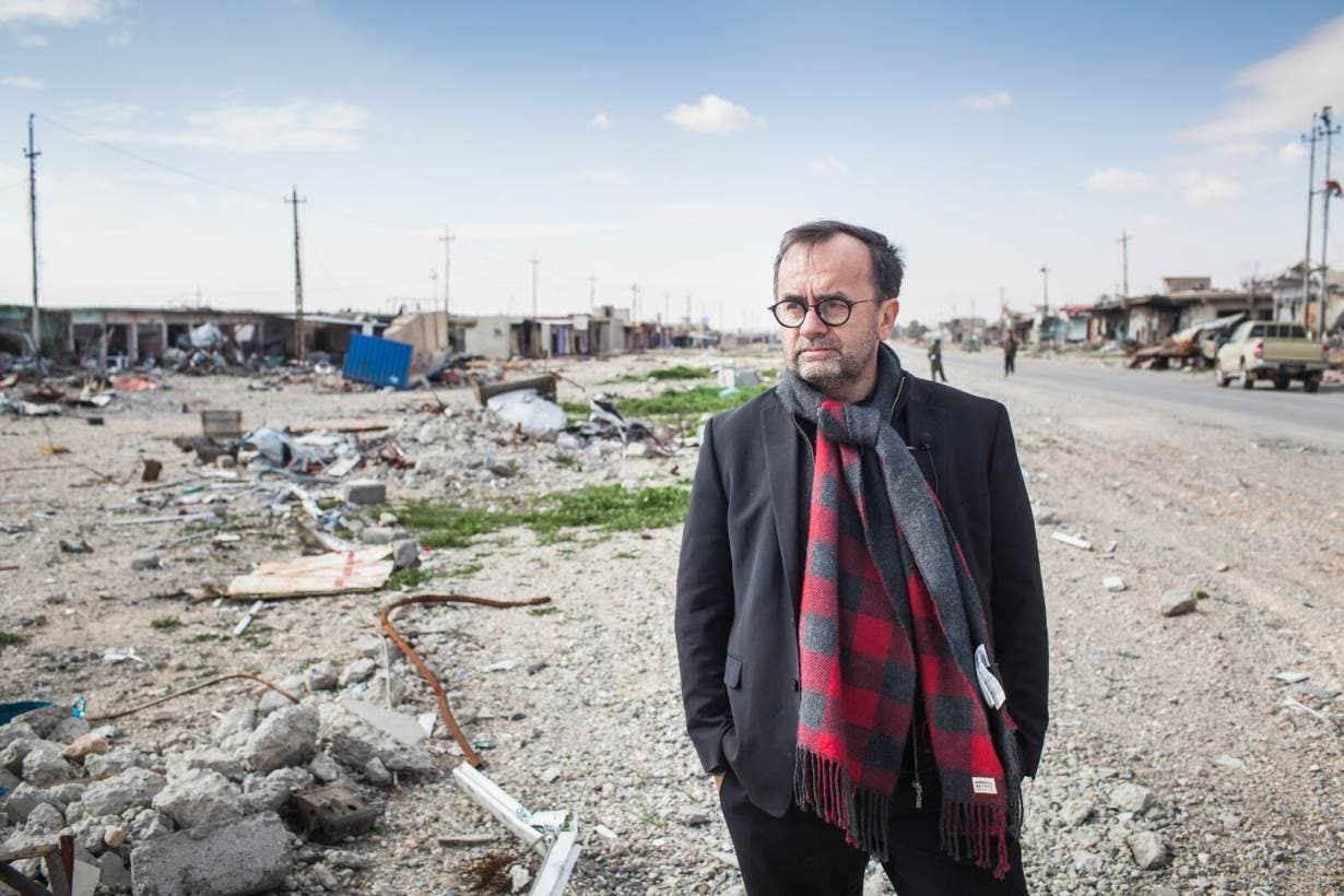 French priest Patrick Desbois stands on the side of a street in Iraq in an undated handout photo. Credit: Yahad In-Unum/Emmanuelle Foussa Thomson Reuters Foundation
