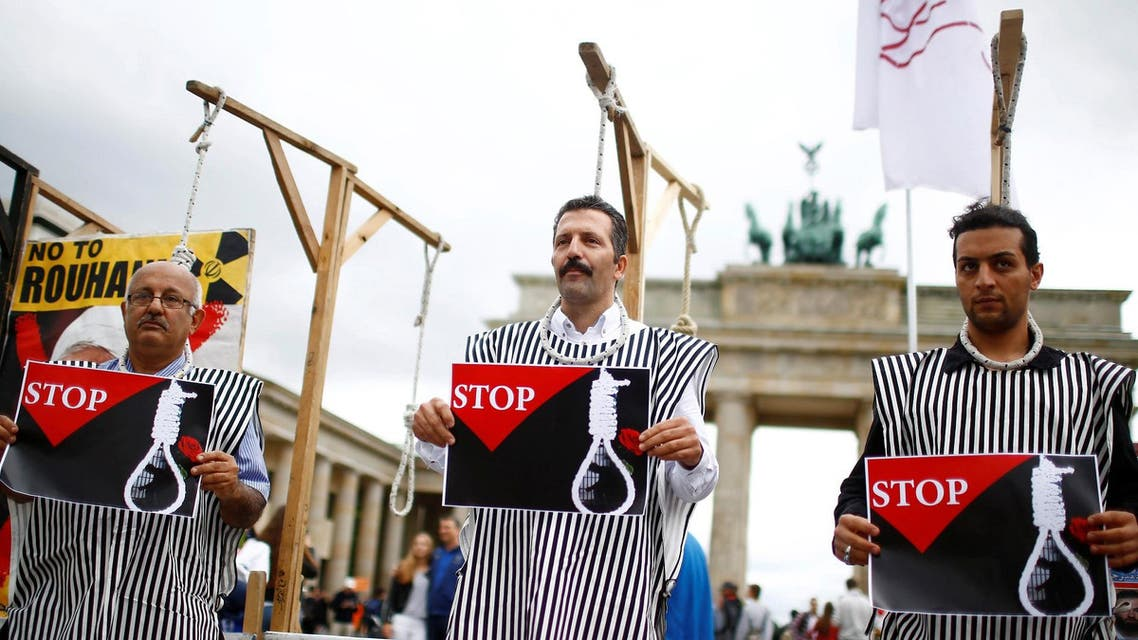 People stage a protest against the recent execution by Iran of up to 20 Kurdish Islamists suspected of attacks on security forces, in front of the Brandenburg gate in Berlin, Germany, August 12, 2016. (Reuters)