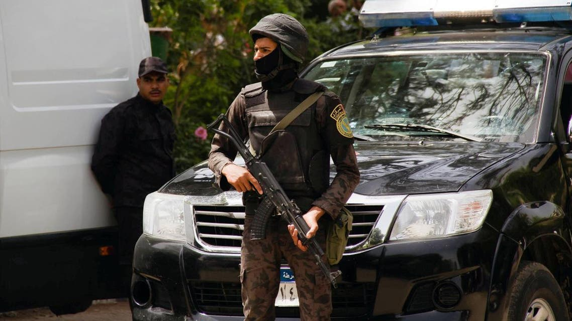 Egyptian security forces stand guard around the Coptic Catholic College of Theology and Humanities in the southern Cairo suburb of Maadi on April 29, 2017. (AFP)