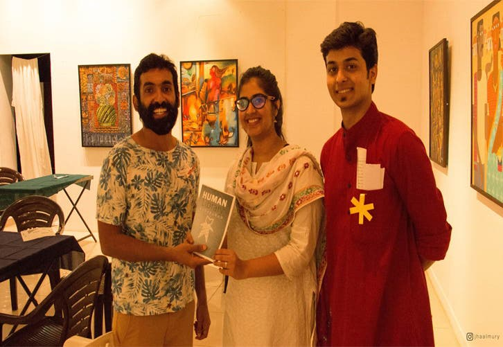 "Harshad and a woman volunteer with the bearded Andy Silviera – the human book titled ""Of Cassocks and Men"". (Supplied)"