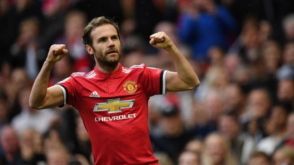Manchester United's Spanish midfielder Juan Mata celebrates scoring the team's first goal during the English Premier League football match between Manchester United and Crystal Palace at Old Trafford in Manchester, north west England, on September 30, 2017. (AFP)