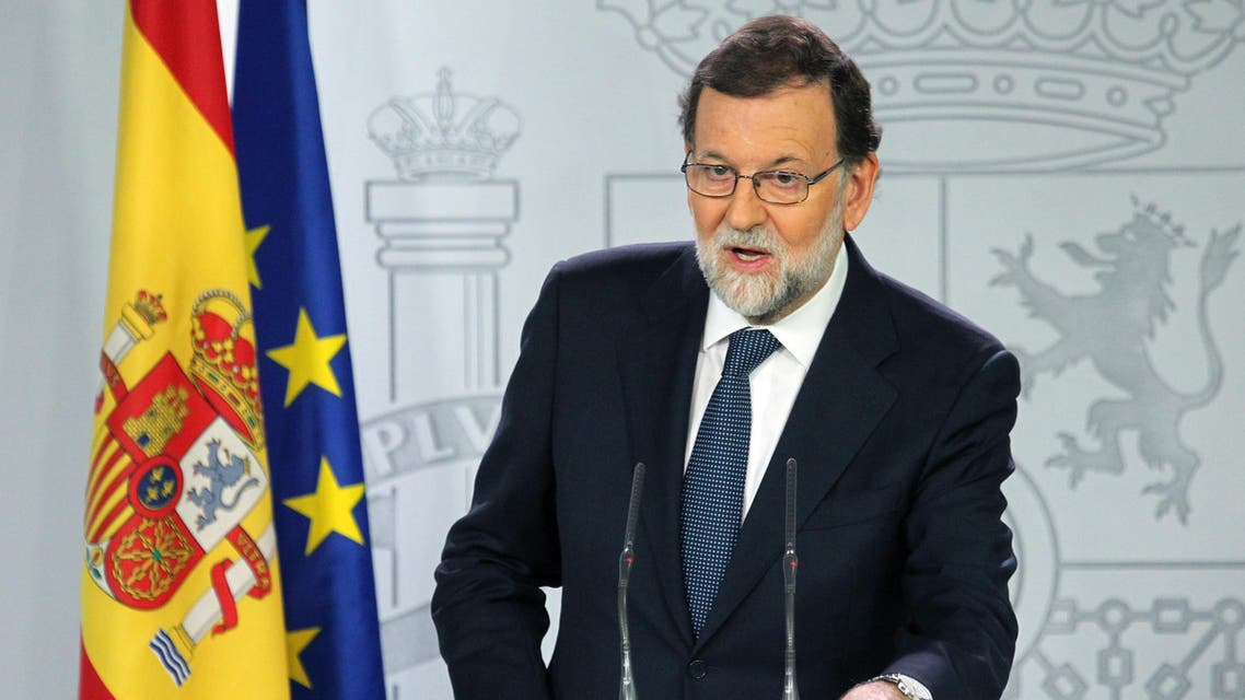 Spain's Prime Minister Mariano Rajoy gives a press conference after a crisis cabinet meeting at the Moncloa Palace on October 11, 2017 in Madrid. ap