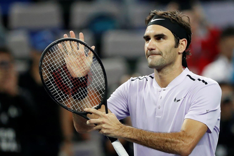 Roger Federer of Switzerland in action against Alexandr Dolgopolov of Ukraine.(Reuters)