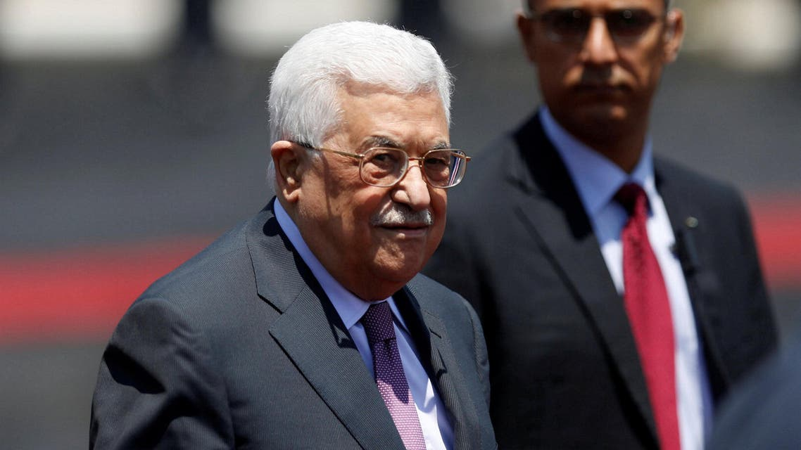 Palestinian President Mahmoud Abbas stands during a reception ceremony for Jordan's King Abdullah II in the West Bank city of Ramallah, August 7, reuters