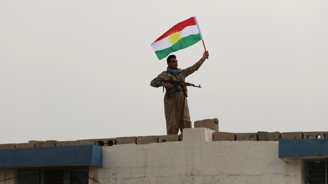 An Iranian Kurdish Peshmerga member of the Kurdistan Democratic Party of Iran (KDP-Iran) holds a Kurdish flag as he takes part in a gathering to urge people to vote in the upcoming independence referendum in the town of Bahirka, north of Arbil, the capital of the autonomous Kurdish region of northern Iraq, on September 21, 2017. The controversial referendum on independence for Iraqi Kurdistan is set for September 25. SAFIN HAMED / AFP