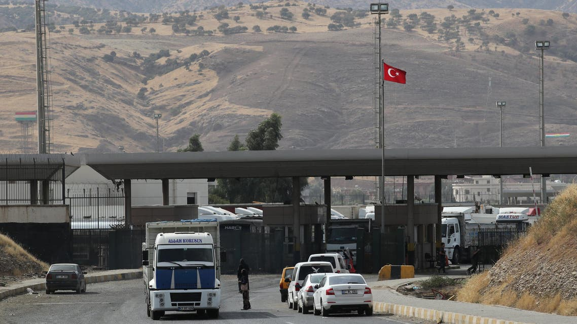Trucks are pictured after crossing the border between Iraq and Turkey as vehicles wait in line to pass Habur border gate near Silopi, Turkey, September 25, 2017. REUTERS/Umit Bektas
