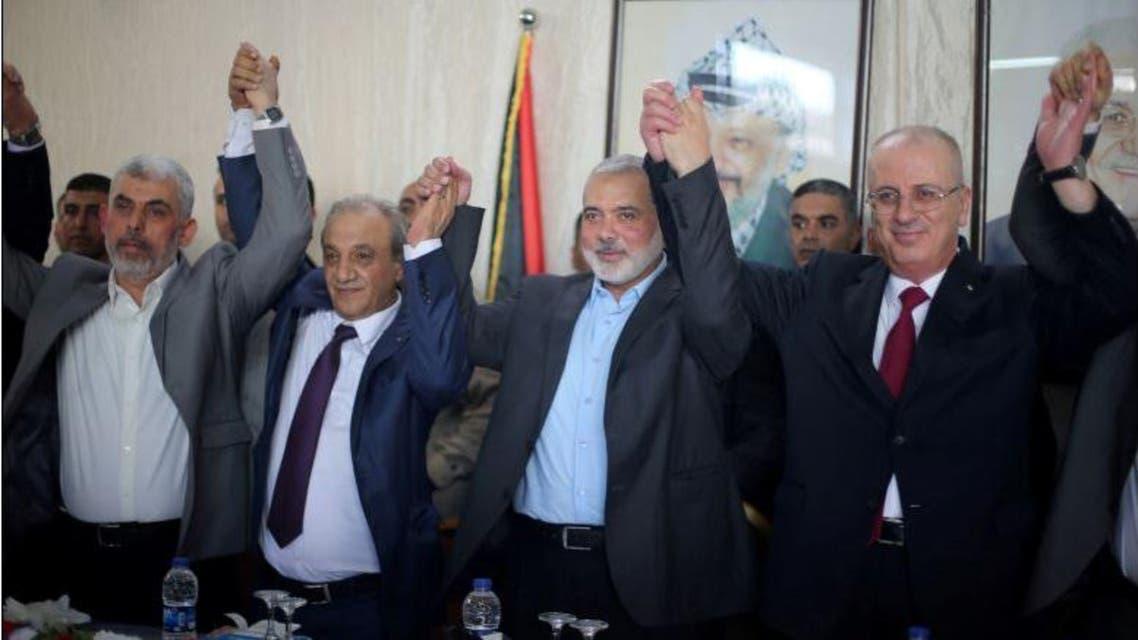 """رئيس الوزراء الفلسطيني رامي الحمدالله ورئيس المكتب السياسي لحماس اسماعيل هنية في غزة """"أرشيفية"""""""