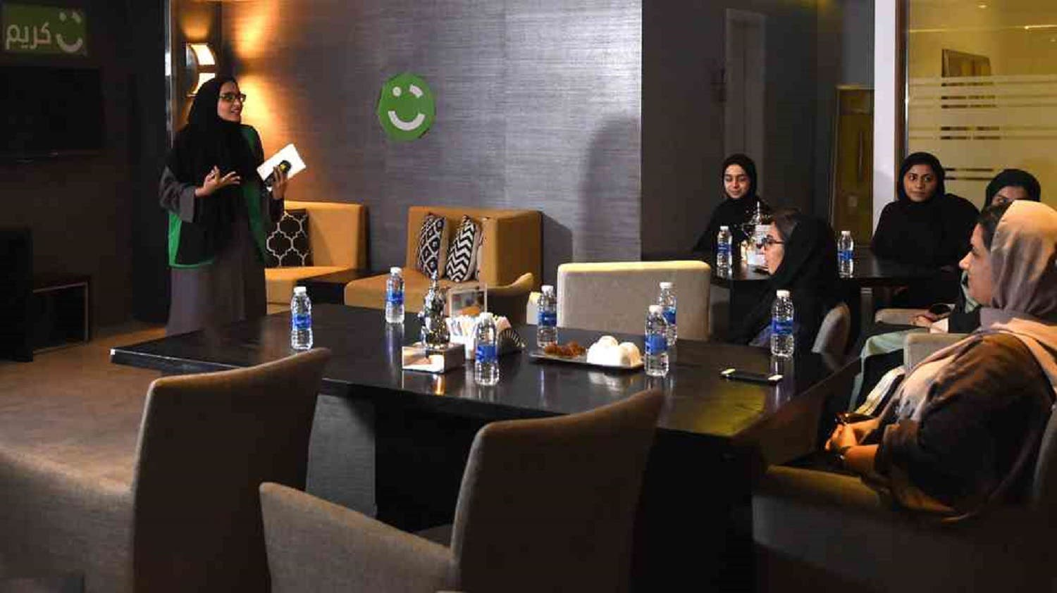 An employee of Careem holds a training session for new female drivers at the firm's Saudi offices in Khobar City. (AFP)