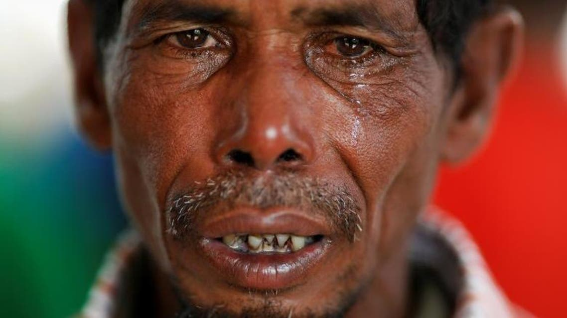 Lalu Miya cries over the bodies of his wife and children, who died after a boat with Rohingya refugees capsized as they were fleeing Myanmar, before the funeral just behind Inani Beach near Cox's Bazar, Bangladesh. (Reuters)
