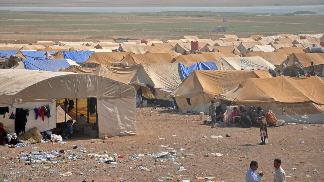Displaced Syrians from Deir Ezzor are seen at a make-shift camp some in the province of Hasakeh on August 2017. (AFP)