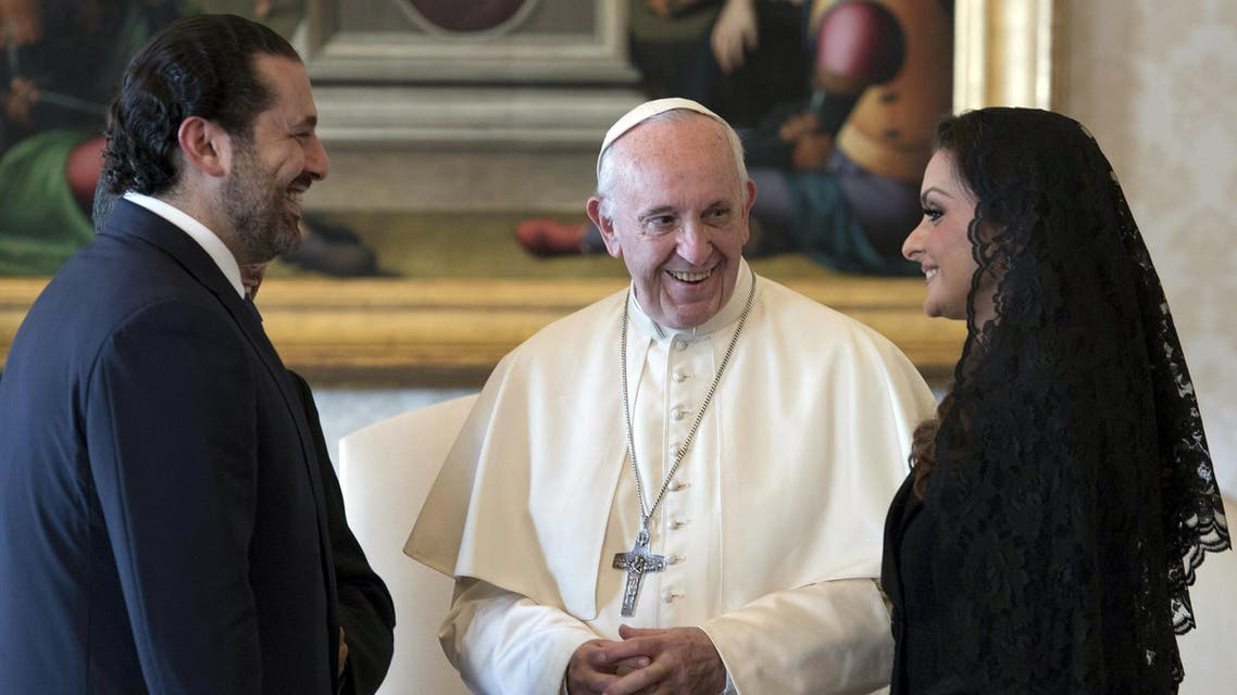 Pope Francis meets Prime Minister of Lebanon Saad Hariri, and his wife Lara, during a private audience at the Vatican, October 13, 2017. REUTERS/Maurizio Brambatti/Pool
