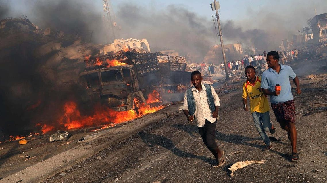 Civilians evacuate from the scene of an explosion in KM4 street in the Hodan district of Mogadishu, Somalia. (Reuters)