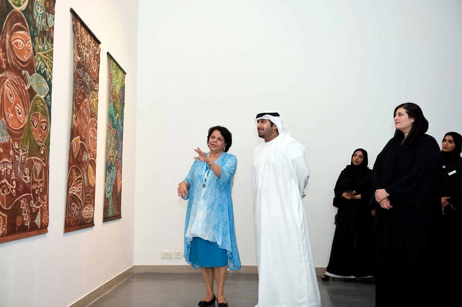 Artist Thuraya Al Baqsami explaining her works during the inauguration of the exhibition to the VIP guests. (Supplied)