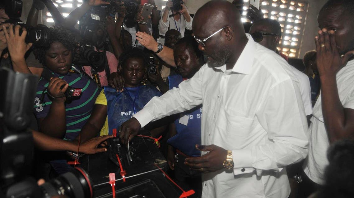 Former soccer star George Weah, Presidential candidate for the Coalition for Democratic Change, cast his vote during a Presidential election in Monrovia, Liberia, on Oct. 10, 2017. (AP)