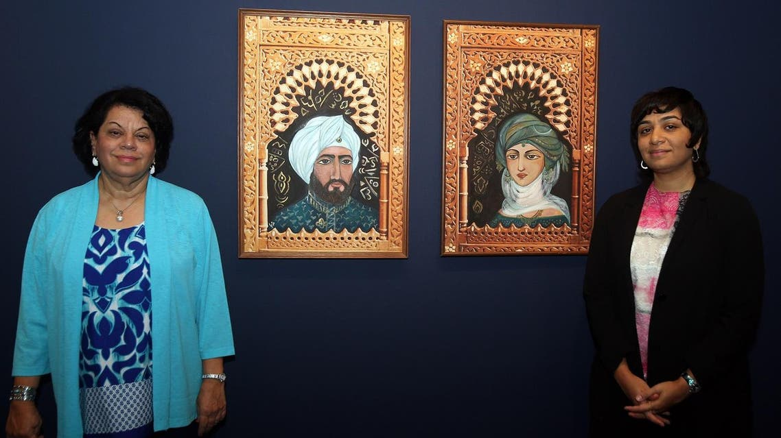 Acclaimed artist Thuraya Al-Baqsami (leftt) and her daughter, Monira Al-Qadiri, at the opening of the exhibition  in Sharjah Art Museum. (Supplied)