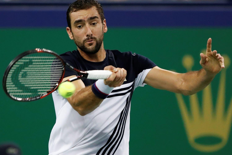 Marin Cilic of Croatia in action against Rafael Nadal of Spain at Shanghai Masters tennis tournament. (Reuters)