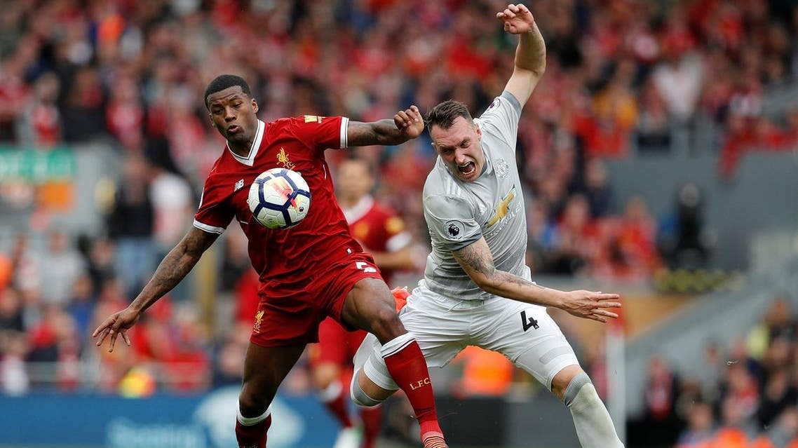 Liverpool's Georginio Wijnaldum in action with Manchester United's Phil Jones in the Premier League  match at  Anfield, Liverpool, Britain on October 14, 2017.(Reuters)