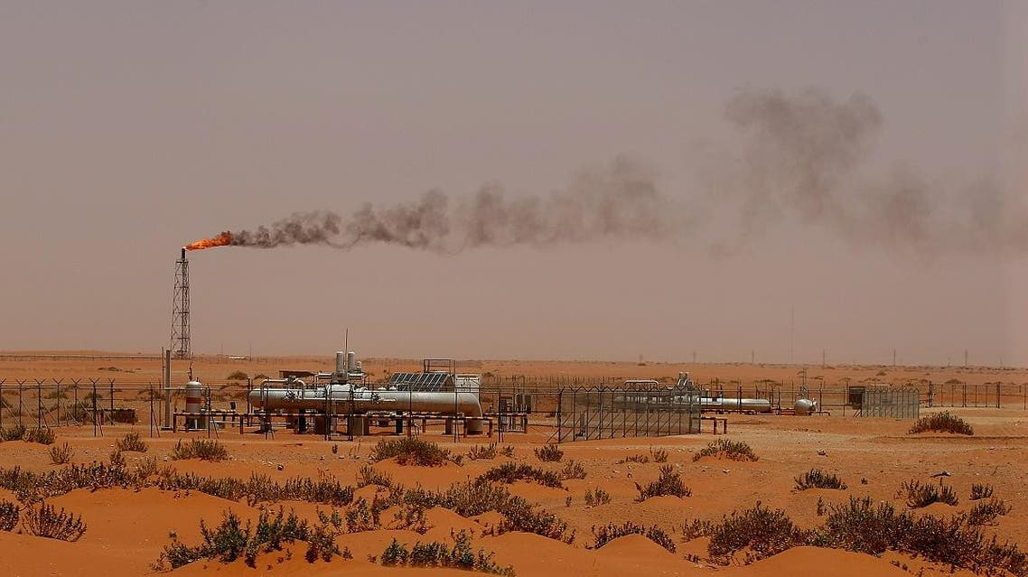 "A flame from a Saudi Aramco oil installion known as ""Pump 3"" is seen in the desert near the oil-rich area of Khouris, 160 kms east of the Saudi capital Riyadh, on June 23, 2008. (AFP)"