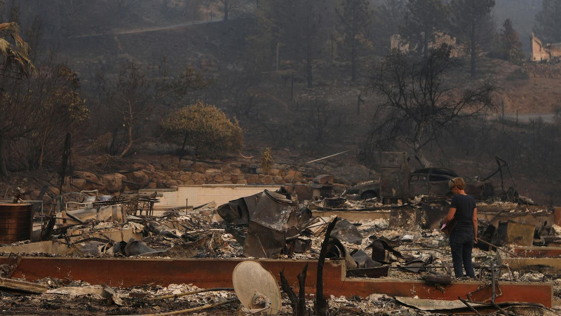 A woman surveys the remains of a home destroyed by wildfire in Napa, California, U.S., October 13, 2017. REUTERS/Jim Urquhart
