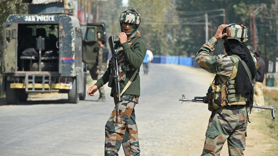 Indian paramilitary troopers stands guard after a gunfight with militants at Hajin village of Kashmir's Bandipora district, north of Srinagar, on October 11, 2017. (AFP)