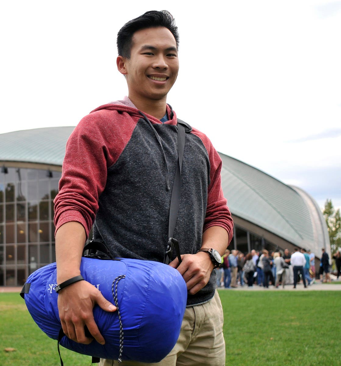 Vick Liu poses with his TravlerPack, a lightweight sleeping bag, outside the Kresge Auditorium at the Massachusetts Institute of Technology in Cambridge, Mass. (AP)