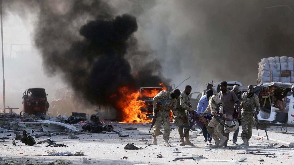 Somali Armed Forces evacuate their injured colleague, from the scene of an explosion in Mogadishu. (Reuters)