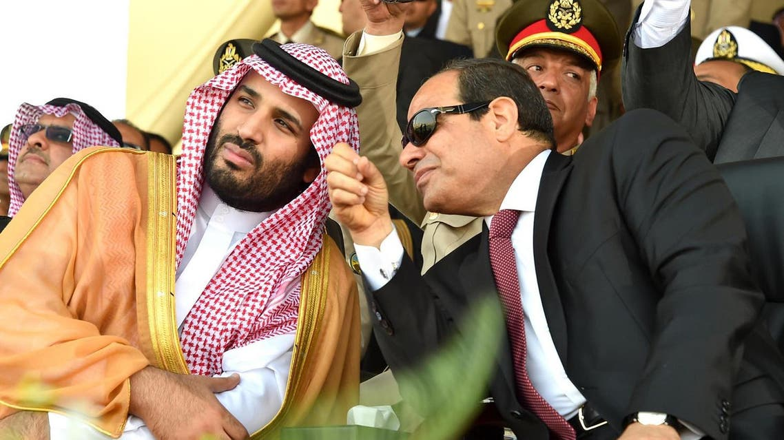 A handout picture provided by the Office of the Egyptian Presidency on July 30, 2015 shows Egyptian President Abdel Fattah al-Sisi (R) speaking with Saudi deputy Crown Prince and Minister of Defence Mohammed bin Salman during a military academy graduation ceremony in the Egyptian capital, Cairo. AFP