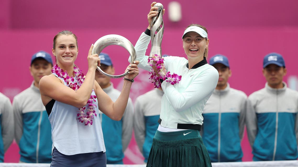 Winner Maria Sharapova of Russia (right) and Aryna Sabalenka of Belarus pose with their trophies after the Tianjin Open Women's singles final on October 15, 2017. (Reuters)