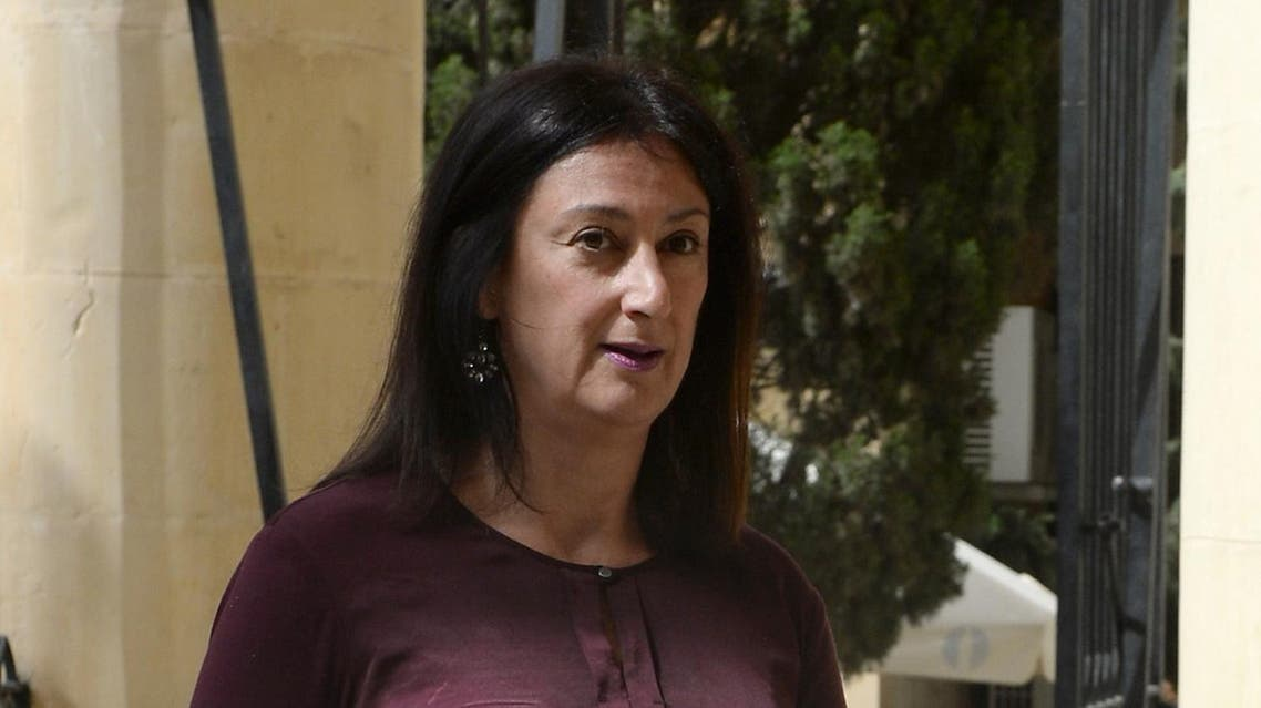 A picture taken on April 27, 2017 shows journalist and blogger Daphne Capuana Galizia arriving at the Law Court in Malta. Capuana Galizia was killed today on October 16, 2017 in a car bomb close to her home in Bidnija, Malta. The force of the blast broke her car into several pieces and catapulted the journalist's body into a nearby field, witnesses said. She leaves a husband and three sons. Caruana Galizia's death comes four months after Prime Minister Joseph Muscat's Labour Party won a resounding victory in a general election he called early as a result of scandals to which Caruana Galizia's allegations were central. (AFP)