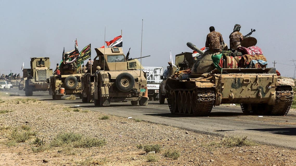Tanks and vehicles of the combined Iraqi forces and Hashed al-Shaabi (Popular Mobilisation) paramilitaries are seen on the advance towards villages between the northern Iraqi cities of Hawija and Kirkuk on October 6, 2017, after retaking Hawija from Islamic State (IS) group fighters a day before. Iraqi forces are pressing an advance up the Euphrates Valley targeting IS' last foothold in the country after it lost the longtime insurgent bastion of Hawija on October 5. (AFP)