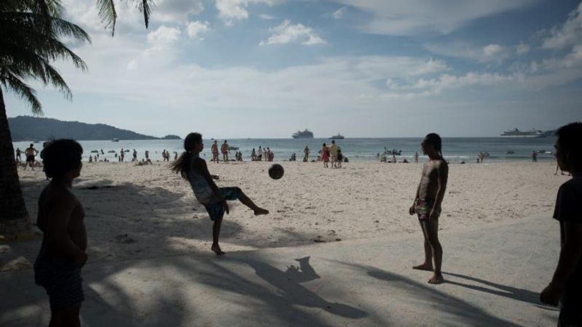 The smoking ban, which comes into force in November, follows a clean-up of nearly 140,000 cigarette butts from a 2.5 kilometre (1.5 miles) stretch of the famed Patong beach in Phuket island province (AFP Photo/NICOLAS ASFOURI)