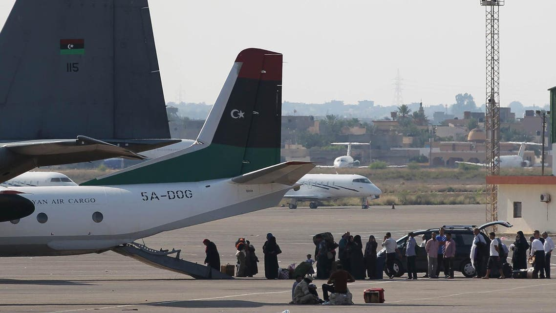 Libyan passengers queue to board a national carrier, bearing the flag of the National Transitional Council (NTC), at Tripoli's Mitiga airport as internal flights between the Libyan capital and the eastern port city of Benghazi were resumed on September 30, 2011. AFP PHOTO/KARIM SAHIB