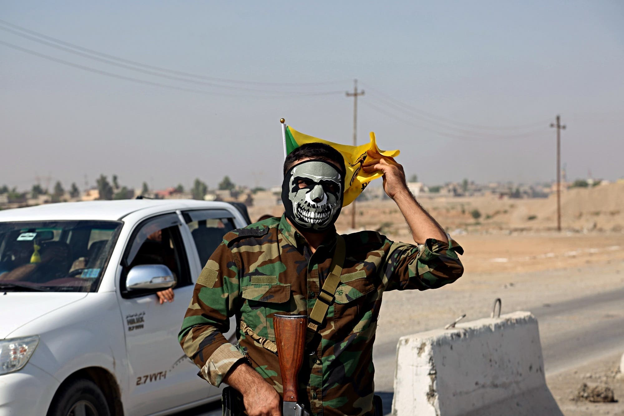 A fighter with Popular Mobilization Forces stands guard in Tuz Khormato, that was evacuated by Kurdish security forces, 210 km north of Baghdad, on Oct. 16, 2017. (AP)