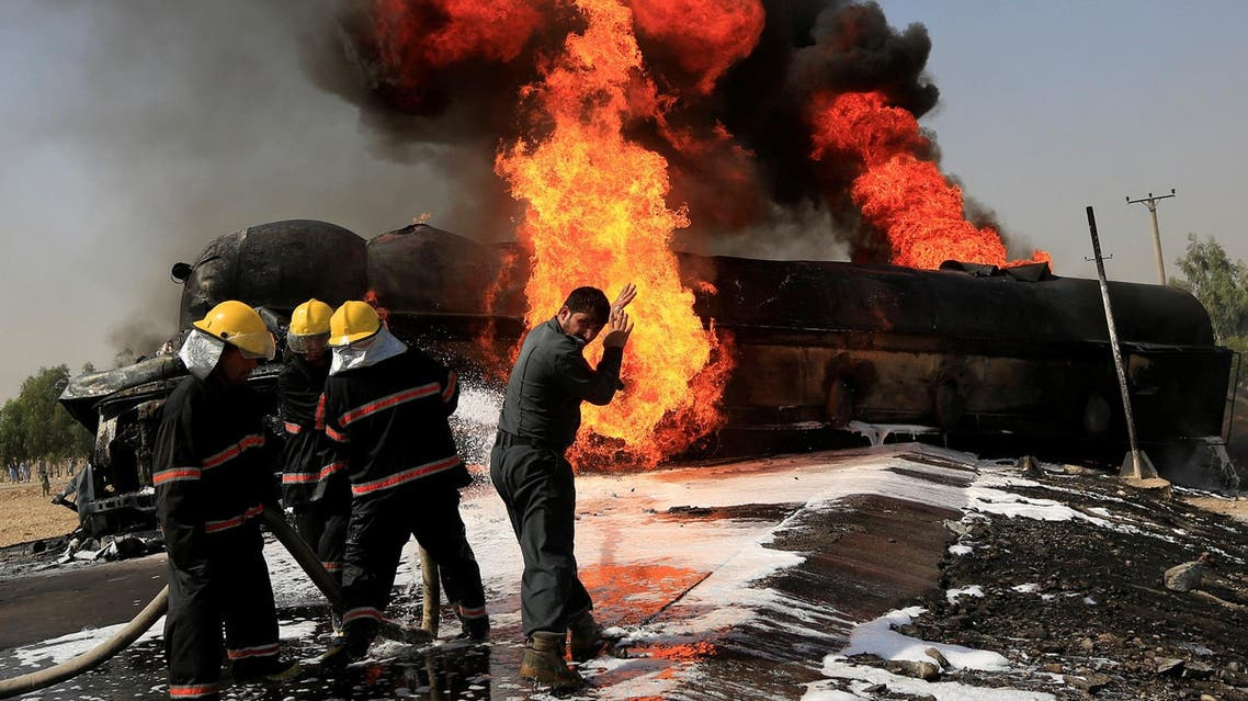 Afghan firefighters attempt to extinguish a burning fuel tanker which was hit by a magnetic bomb on the outskirts of Jalalabad, Afghanistan, on October 16, 2017. (File photo: Reuters)