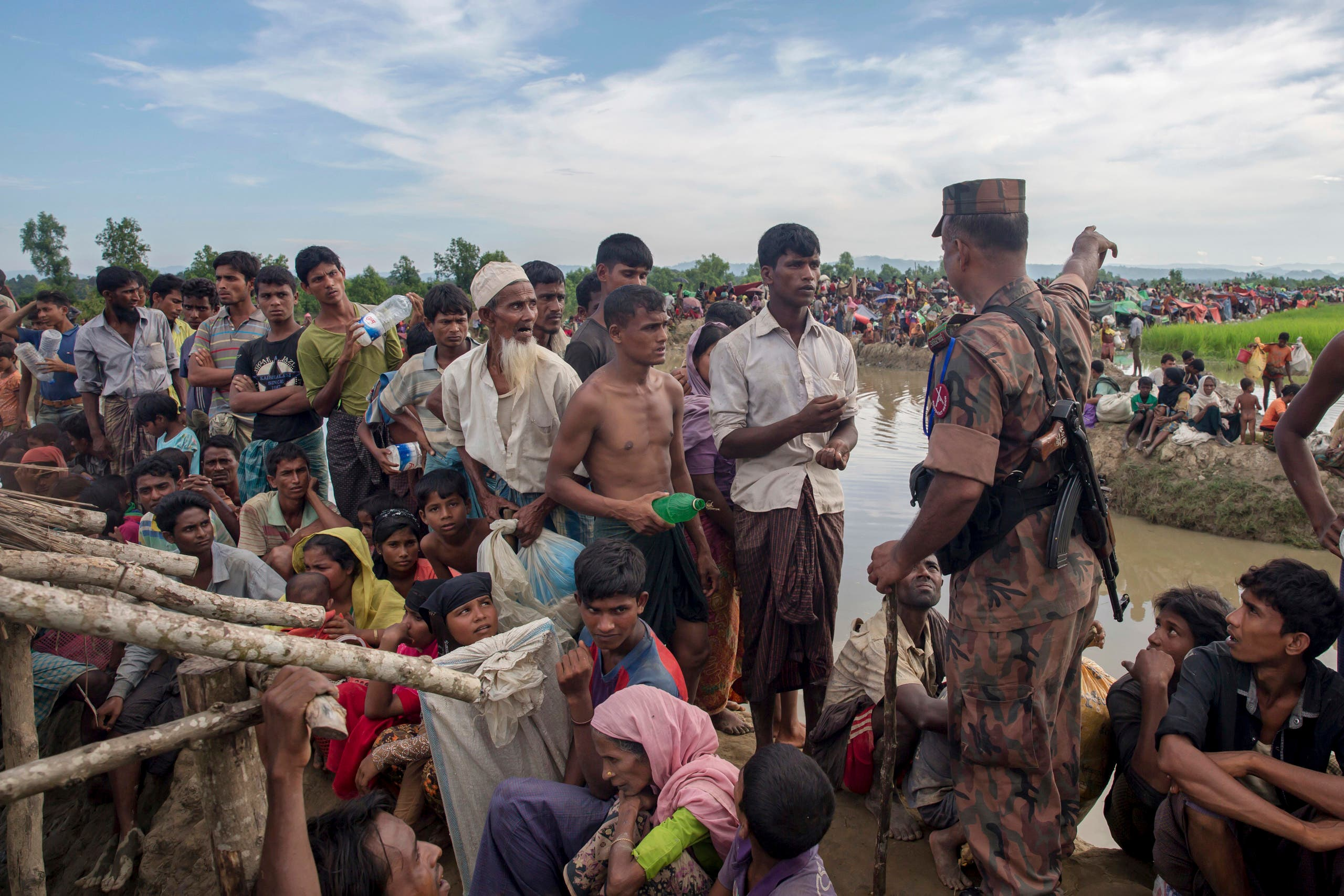 Thousands more Rohingya Muslims are fleeing large-scale violence and persecution in Myanmar and crossing into Bangladesh. (AP)