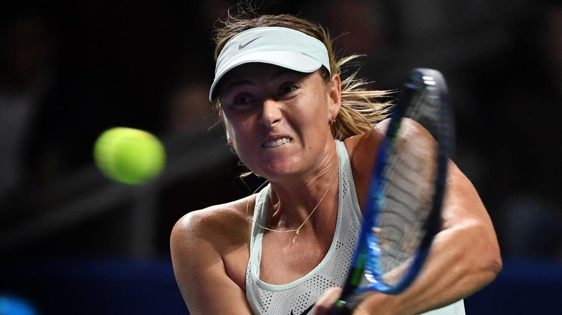 Russia's Maria Sharapova returns the ball to Slovakia's Magdalena Rybarikova during the women's singles first round tennis match at the Kremlin Cup tennis tournament in Moscow on October 17, 2017. (AFP)