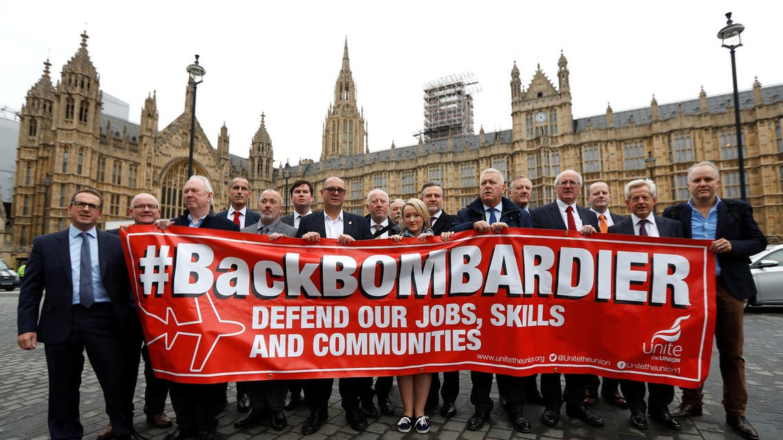 Members of Britain's Unite trade union protest outside the Houses of Parliament in support of Bombardier workers in London, Britain, October 11, 2017. Reuters