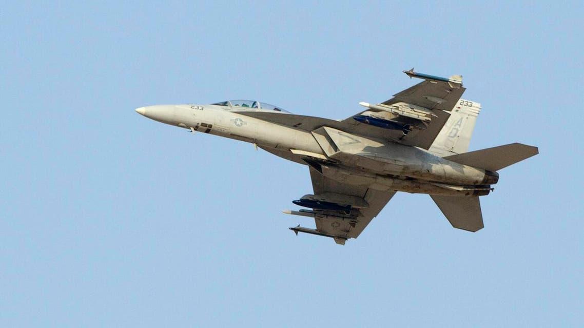 An F18 Super Hornet fighter jet flies during the Dubai Airshow November 18, 2013. REUTERS/Caren Firouz (UNITED ARAB EMIRATES - Tags: BUSINESS TRANSPORT MILITARY)