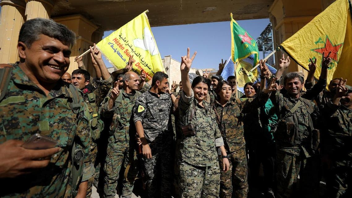 """Fighters of Syrian Democratic Forces gesture the """"V"""" sign in Raqqa, Syria. (Reuters)"""