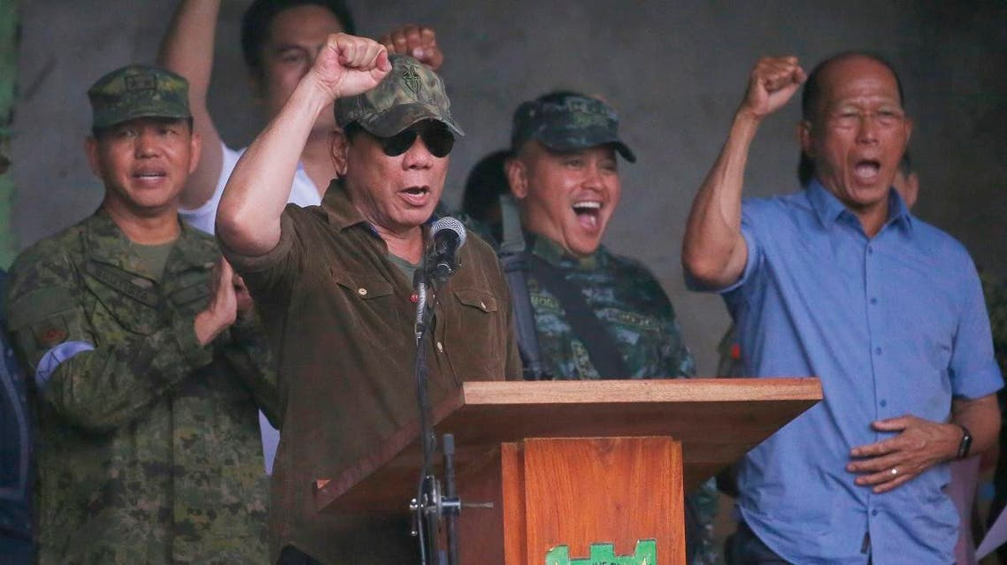 President Rodrigo Duterte cheers as he declares the liberation of Marawi city in southern Philippines after almost five months of the siege by pro-ISIS. (AP)