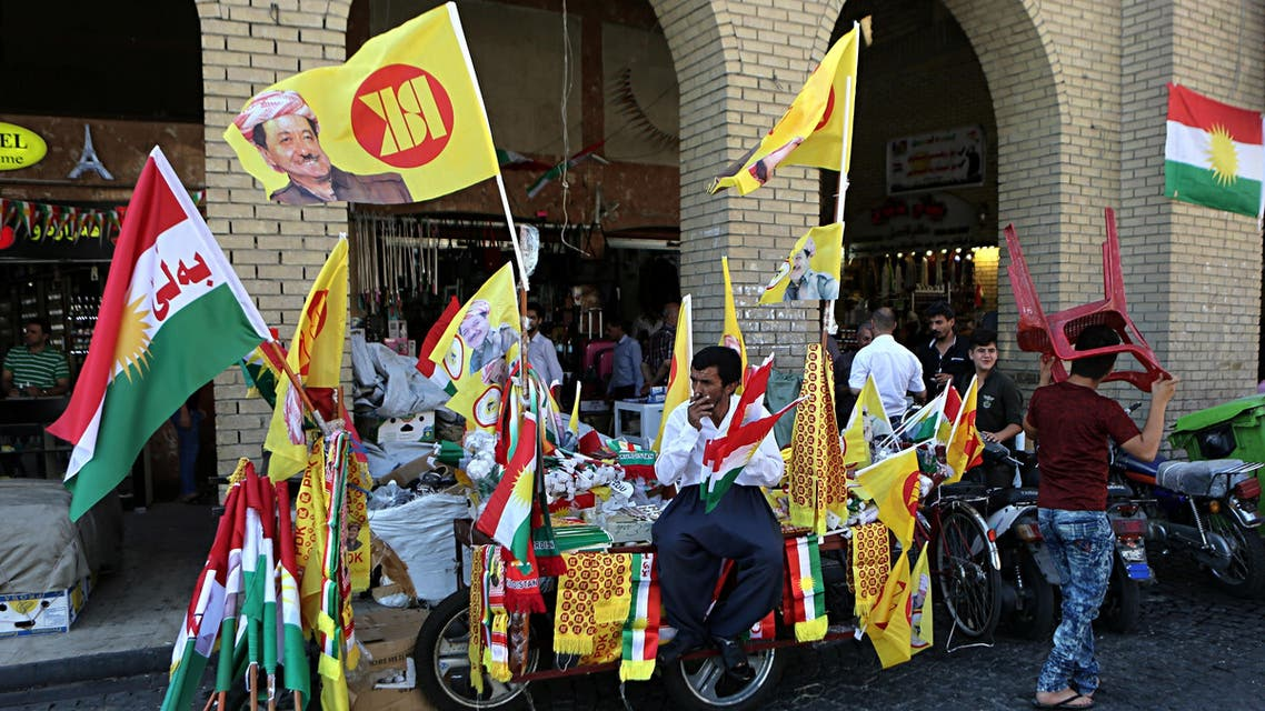 A street vendor sells Kurdish flags and pro-independence items in central Irbil, 217 miles (350 kilometers) north of Baghdad, Iraq, Sunday, Sept. 24, 2017. AP