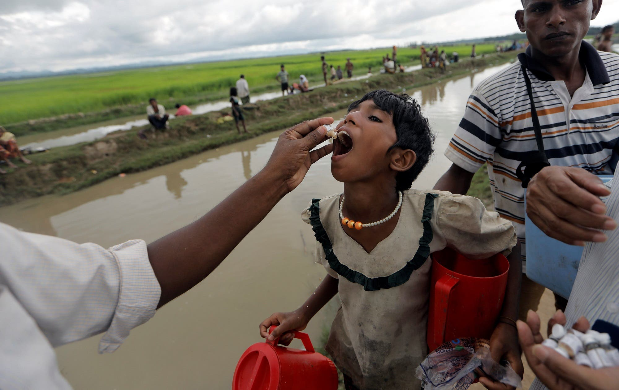 A Rohingya refugee gets an oral cholera vaccine in Palang Khali, near Cox's Bazar, Bangladesh, October 17, 2017. (Reuters)