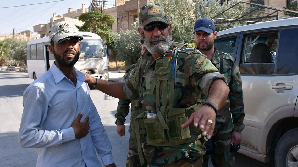 Issam Zahreddine (R) Major General of the Syrian Republican Guard, talks with a civilian in the eastern city of Deir Ezzor on September 10, 2017, as they continue to press forward with Russian air cover in the offensive against Islamic State group jihadists across the province. (AFP)