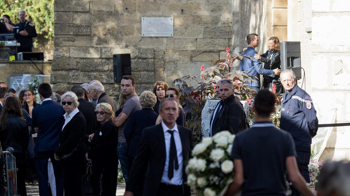 People attend the funerals of two victims of an attack in the coastal city of Marseille at the church of Eguilles. (AFP)