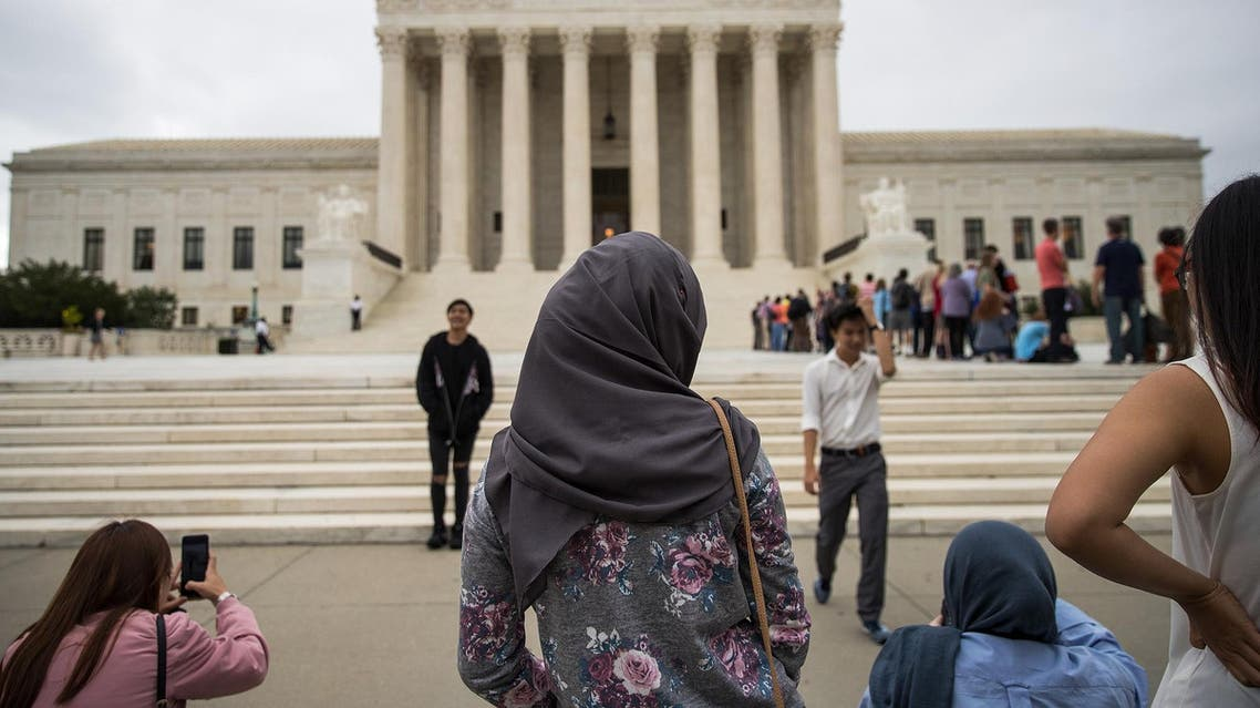 A woman wearing a hijab stands outside the US Supreme Court, October 11, 2017. (AFP)