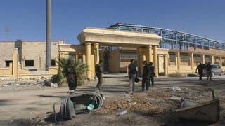 تنظيف ملعب الرقة الذي كان سجنا تحت حكم داعش