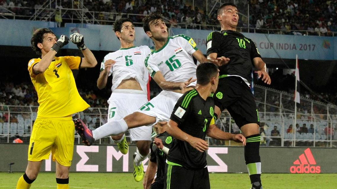 Iraq's Ali Ibadi, Muntadher Mohammed and Abdullabbas Ayad duel for the ball against Mexico's Roberto De La Rosa and Carlos Robles during the FIFA U-17 World Cup match in Kolkata, India. (AP)